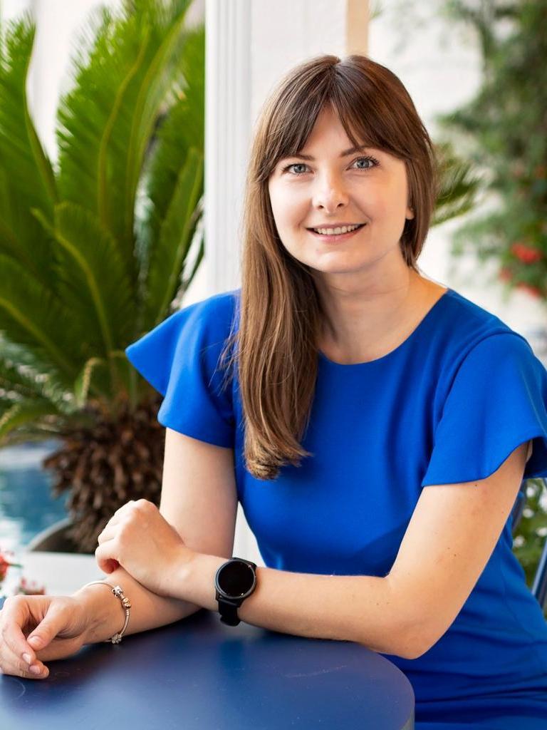 Iryna Snizhenko - Blue Avenue Real Estate Team Profile Photo