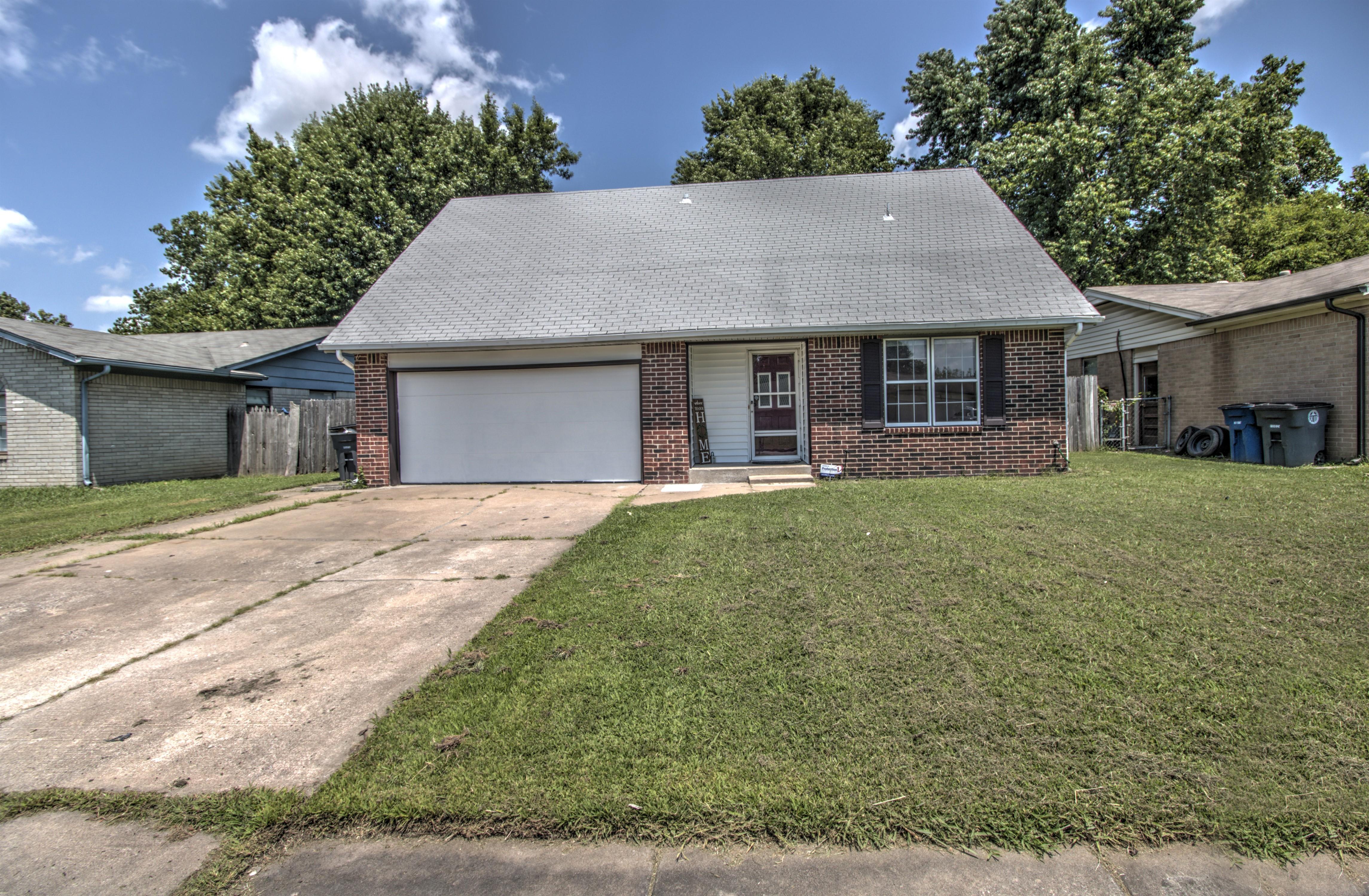11411 E 37th Place Property Photo 1