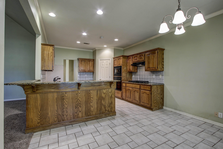 9123 N 102nd East Avenue Property Photo 8